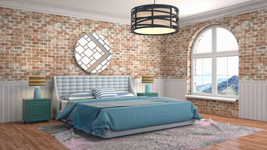 Chambre à coucher style retrò avec mur en briques apparentes.
